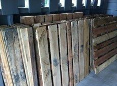 Old wooden pallets + Good pair of pliers + Hours of work = Awesome Wooden Floor!